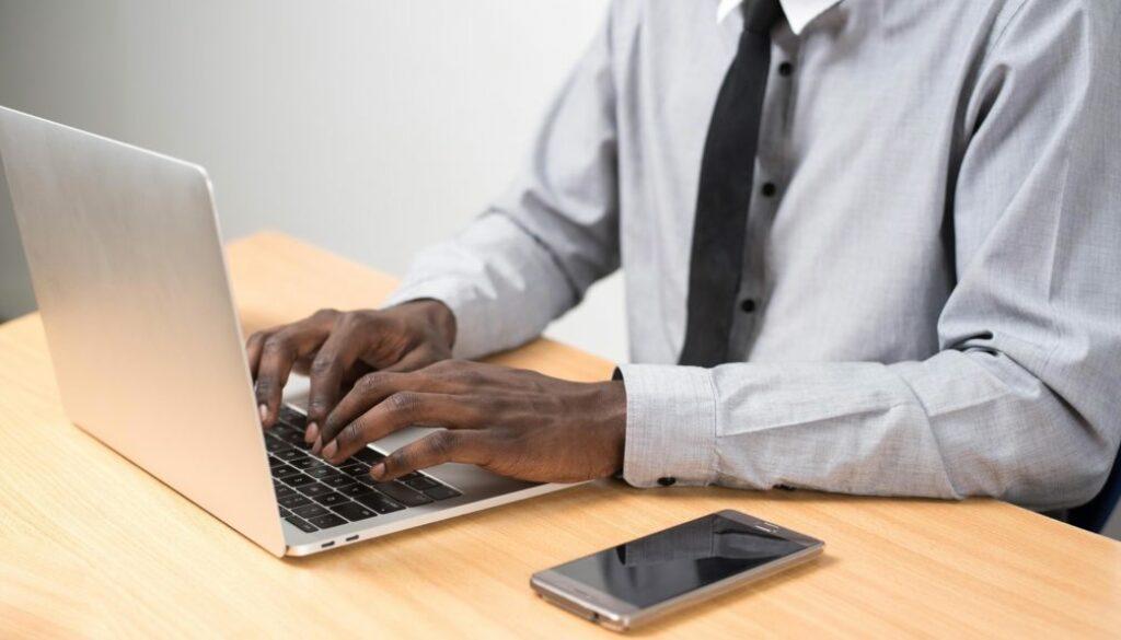 Man-using-laptop-CU